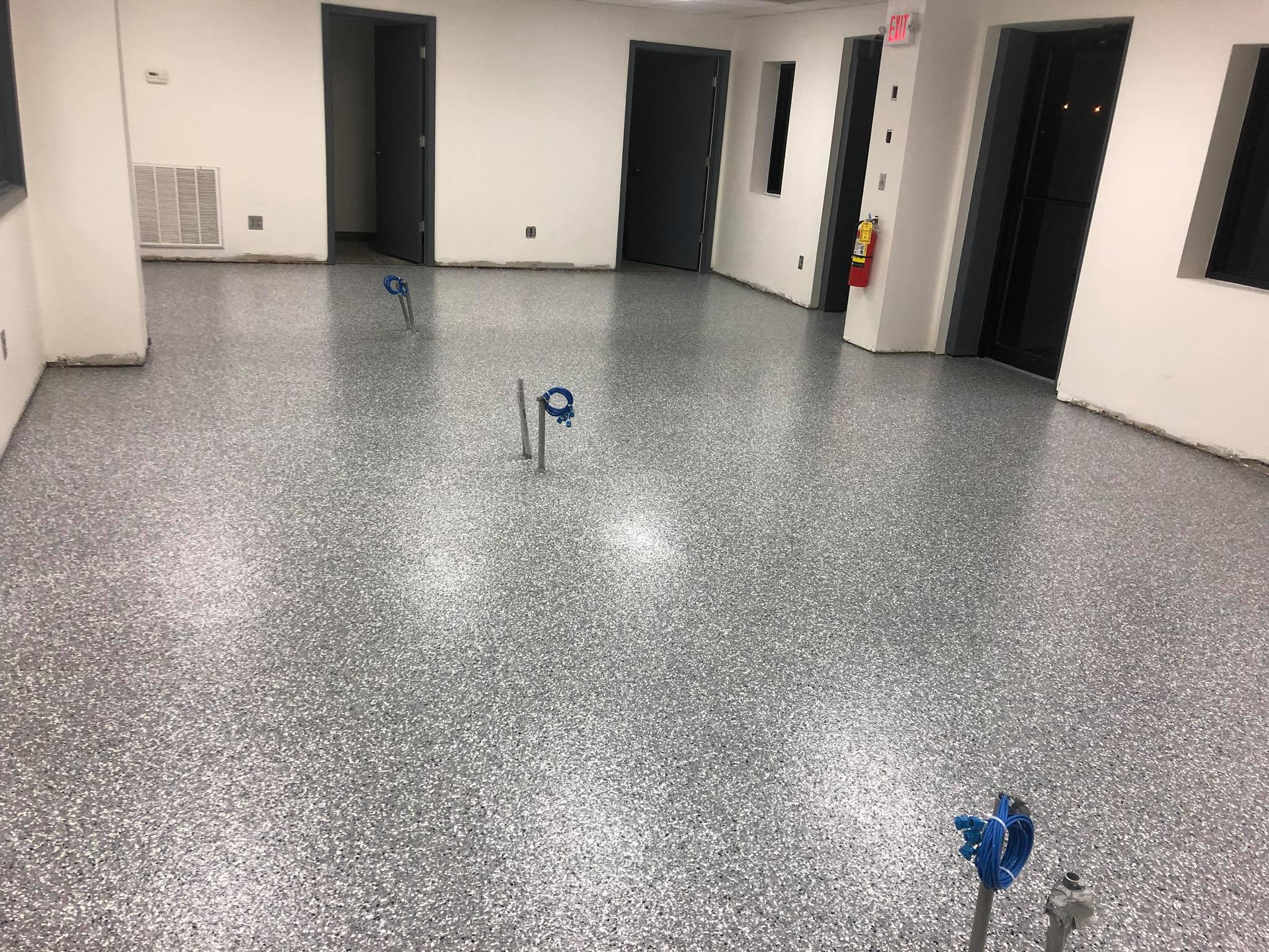 Epoxy and flake with a polyurea topcoat for a commercial showroom.